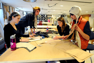 Kendra Cutter, left, Sara Hildebrand, Deirdre Graham, and Jon Kimball, have a brainstorming session during class. University of Colorado students do class work in the costume technology class on Friday.  For more photos and a video, go to www.dailycamera.com. Cliff Grassmick / October 21, 2011
