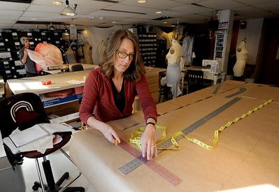 "Shop Manager, Brenda King, cuts out a pattern of a giant ""Jesus""  at the costume shop at the University of Colorado Theatre building. For a video of the costume shop, go to www.dailycamera.com Cliff Grassmick / October 18, 2011"