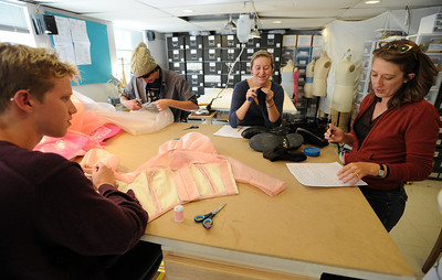 "David Smithey, left,  John Kimball, Hayley Gocha, and shop manager Brenda King, work on costumes for the show, ""14"" in the University of Colorado Theater costume shop. For a video of the costume shop, go to www.dailycamera.com Cliff Grassmick / October 18, 2011"