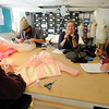"David Smithey, left,  John Kimball, Hayley Gocha, and shop manager Brenda King, work on costumes for the show, ""14"" in the University of Colorado Theater costume shop.<br /> For a video of the costume shop, go to  <a href=""http://www.dailycamera.com"">http://www.dailycamera.com</a><br /> Cliff Grassmick / October 18, 2011"