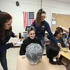 """Chelmsford High is a host for the METG theatre festival of one-act plays. Chelmsford High group gets ready to perform """"A Head of the Class,"""" a play written years ago by Chelmford High student Eloise Hoffman. From left, Kate Heinman, removing lint for Olivia Buckley, who was having wig put on by Stephanie Bianco, and Madison Good, having hair prepared by Maggie Potter.  (SUN/Julia Malakie)"""