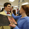 """Chelmsford High is a host for the METG theatre festival of one-act plays. Chelmsford High group gets ready to perform """"A Head of the Class,"""" a play written years ago by Chelmford High student Eloise Hoffman. Junior Lauren Pratt does makeup for sophomore Chase Boles. (SUN/Julia Malakie)"""