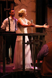 """Todd Schaefer (background) and Taylor Pietz singing """"Don't Cry for Me, Argentina,"""" in New Line Theatre's EVITA. Photo credit: Jill Ritter"""