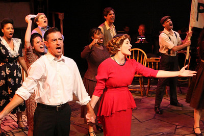 """Todd Schaefer, Taylor Pietz, and the company singing """"A New Argentina"""" in New Line Theatre's EVITA. Photo credit: Jill Ritter"""
