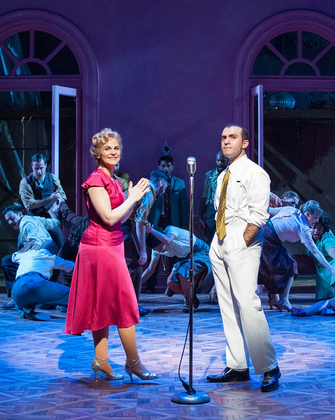 Rachel Zampelli as Eva, Nick Duckart as Juan Perón, and the cast of Olney Theatre Center's production of EVITA. (Photo: Stan Barouh)