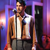 Robert Ariza as Che in Olney Theatre Center's production of EVITA (Photo: Stan Barouh)