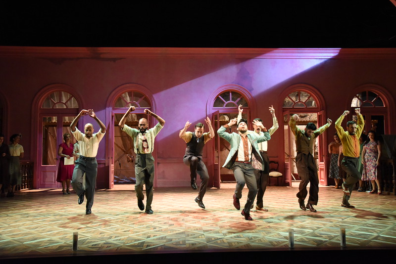 Robert Ariza as Che and the cast of Olney Theatre Center's production of EVITA (Photo: Stan Barouh)