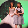 Fitchburg High School presented a performance for its annual spring musical, The Wizard of Oz, directed by senior Tabitha Greenlees on Wednesday. Dorothy, in center, played by junior Ryan O'Neil, makes a wish to go back home. In back, senior Rachel Webber played Glinda; at right, junior Jazmin Howard played the scarecrow. SENTINEL & ENTERPRISE/ ASHLEY LUCENTE