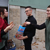 Chelmsford High is a host for the METG theatre festival of one-act plays. Fitchburg High group breaks down their set after performance. From left, senior Teresa French, junior Josiah Begor, and senior Sara Love, eat pretzels after loading the set into a truck. (SUN/Julia Malakie)