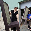 Chelmsford High is a host for the METG theatre festival of one-act plays. Fitchburg High group breaks down their set after performance. Judy Hanson, left, and sophomore Hannah Dunton, wait to load set chairs onto the truck. (SUN/Julia Malakie)