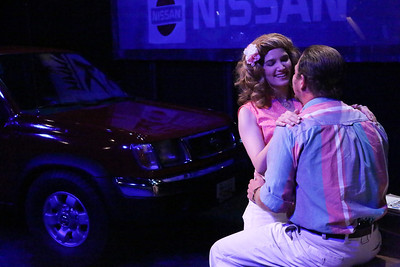 """Taylor Pietz as Heather Stovall and Mike Dowdy as Mike Ferris, singing """"Burn That Bridge,"""" in New Line Theatre's HANDS ON A HARDBODY, 2014. Photo credit: Jill Ritter Lindberg."""