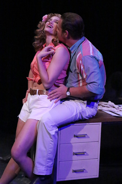 "Taylor Pietz as Heather Stovall and Mike Dowdy as Mike Ferris, singing ""Burn That Bridge,"" in New Line Theatre's HANDS ON A HARDBODY, 2014. Photo credit: Jill Ritter Lindberg."