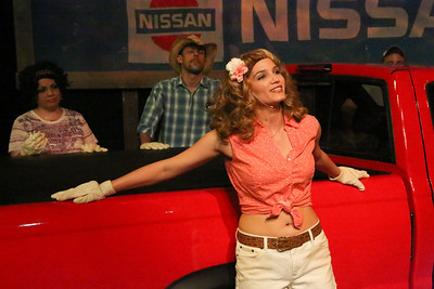 """Taylor Pietz (in front) as Heather Stovall, singing """"If I Had This Truck,"""" with Anna Skidis as Norma Valverde and Todd Schaefer as JD Drew, in New Line Theatre's HANDS ON A HARDBODY, 2014. Photo credit: Jill Ritter Lindberg."""