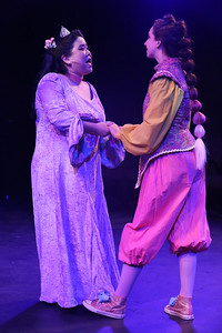 """Grace Langford (left) as Princess Pamela, and Jaclyn Amber as her handmaiden Mopsa, singing """"Our Lips Are Sealed,"""" in New Line Theatre's HEAD OVER HEELS, 2020. Photo credit: Jill Ritter Lindberg."""