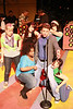 """Jeffrey M. Wright as Rob Gordon, surrounded by Rob's Ex-Girlfriends, singing """"Desert Island All-Time Top 5 Breakups"""" in New Line Theatre's """"High Fidelity,"""" 2012. Photo credit: Jill Ritter Lindberg."""