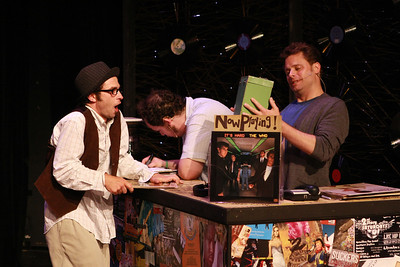 """Todd Micali as TMPMITW and Jeffrey M. Wright as Rob Gordon taking a look at The Mother Lode in New Line Theatre's """"High Fidelity,"""" 2012. Photo credit: Jill Ritter Lindberg."""