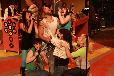 """Laura (Kimi Short, center) and the Ex-Girlfriends surround Ian (Aaron Allen) in a fantasy orgy in """"Number 5 With a Bullet"""" in New Line Theatre's """"High Fidelity,"""" 2012. Photo credit: Jill Ritter Lindberg."""