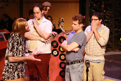 """Aaron Allen as Ian, Zachary Allen Farmer as Barry, Jeffrey M. Wright as Rob, and Mike Dowdy as Dick, in New Line Theatre's """"High Fidelity,"""" 2012. Photo credit: Jill Ritter Lindberg."""