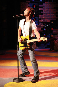 """Todd Micali as Bruce Springsteen, singing """"Goodbye and Good Luck"""" in New Line Theatre's """"High Fidelity,"""" 2012. Photo credit: Jill Ritter Lindberg."""