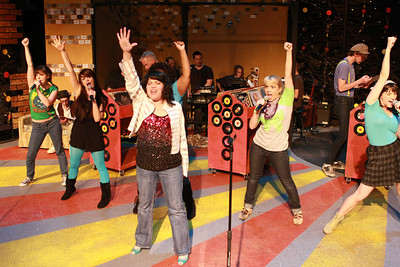"""Kimi Short as Laura (in front) singing """"Number 5 With a Bullet,"""" with Rob's Ex-Girlfriends (Terrie Carolan, Chrissy Young, Talichia Noah [hidden], Sarah Porter, Taylor Pietz), in New Line Theatre's """"High Fidelity,"""" 2012. Photo credit: Jill Ritter Lindberg."""