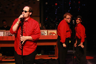 """Zachary Allen Farmer as Barry, singing the finale, """"Turn the World Off,"""" backed up by Nicholas Kelly as Klepto-Boy and Todd Micali as TMPMITW, in New Line Theatre's """"High Fidelity,"""" 2012. Photo credit: Jill Ritter Lindberg."""