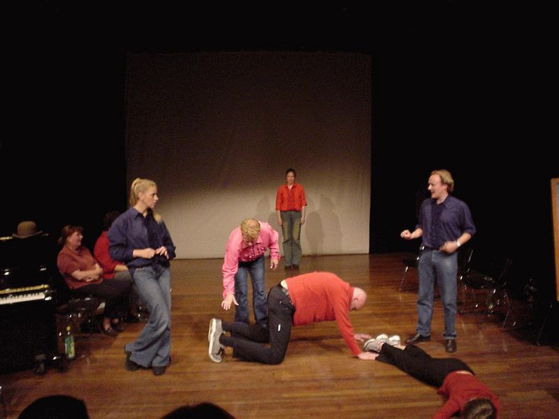 "Six act ""The Racetrack"". One team gets a penalty and must perform as a stage piece in the other team's act."