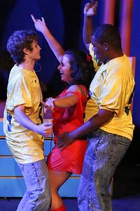 "Kurt (Clayton Humburg), Heather Chandler (Sicily Mathenia), and Ram (Omega Jones) sing ""Big Fun,"" in New Line Theatre's HEATHERS, 2015. Photo credit: Jill Ritter Lindberg."