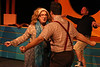 """Ms. Fleming (Lindsey Jones) and the Beleaguered Geek (Alex Glow),  with Ram's Dad (Chris Kernan) in the background, singing """"My Dead Gay Son,"""" in New Line Theatre's HEATHERS, 2015. Photo credit: Jill Ritter Lindberg."""