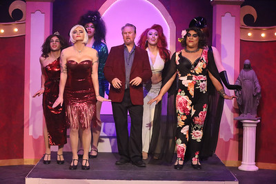 Robert Doyle (center) as Georges, surrounded by the Cagelles, singing the finale in LA CAGE AUX FOLLES, New Line Theatre, 2019. Photo credit: Jill Ritter Lindberg.