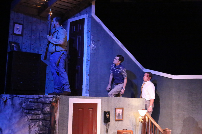 "(l-r) Zachary Allen Farmer as Ben, Joseph McAnulty as Tom, and Mike Dowdy as Harry, exploring the upstairs in New Line Theatre's ""Night of the Living Dead,"" 2013. Photo credit: Jill Ritter Lindberg."