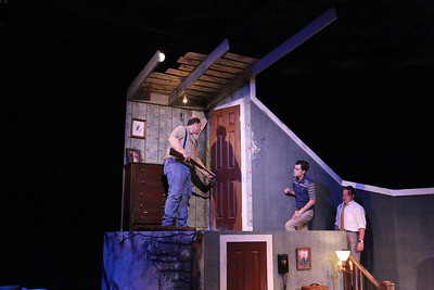 """(l-r) Zachary Allen Farmer as Ben, Joseph McAnulty as Tom, and Mike Dowdy as Harry, exploring the upstairs in New Line Theatre's """"Night of the Living Dead,"""" 2013. Photo credit: Jill Ritter Lindberg."""