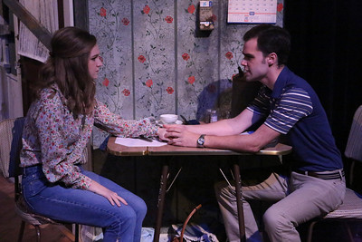 """(l-r) Mary Beth Black as Judy and Joseph McAnulty as Tom, singing """"We'll Be Alright"""" in New Line Theatre's """"Night of the Living Dead,"""" 2013. Photo credit: Jill Ritter Lindberg."""