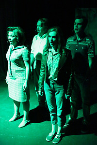"""Sarah Porter as Helen, Mike Dowdy as Harry, Mary Beth Black as Judy, and Joseph McAnulty as Tom, in the prologue to New Line Theatre's """"Night of the Living Dead,"""" 2013. Photo credit: Jill Ritter Lindberg."""