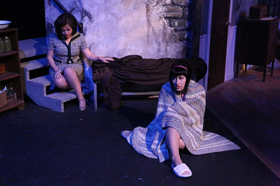 """Sarah Porter as Helen and Marcy Wiegert as Barbra, waiting in the cellar, in New Line Theatre's """"Night of the Living Dead,"""" 2013. Photo credit: Jill Ritter Lindberg."""