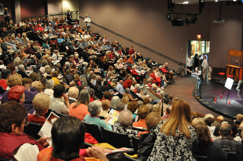 """Landon urges the audience to squeeze together and identify open seats. """"I feel like I'm at Sea World!"""" brought laughter and cooperation from a sell-out crowd."""