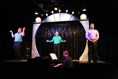 """Mike Dowdy-Windsor, Sean Michael, and Dominic Dowdy-Windsor singing """"Getting Married Today,"""" with Nate Jackson on the piano, in OUT ON BROADWAY: THE THIRD COMING, New Line Theatre, 2017. Photo credit: Jill Ritter Lindberg."""