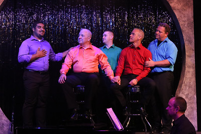 """Dominic Dowdy-Windsor (left), singing """"Family,"""" with Ken Haller, Sean Michael, Keith Thompson, and Mike Dowdy-Windsor, with Nate Jackson on the piano, in OUT ON BROADWAY: THE THIRD COMING, New Line Theatre, 2017. Photo credit: Jill Ritter Lindberg."""