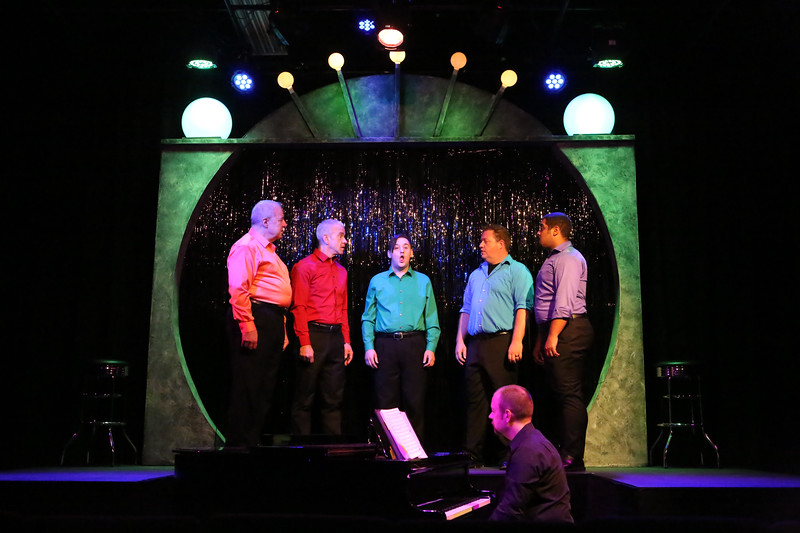 "Ken Haller, Keith Thompson, Sean Michael, Mike Dowdy-Windsor, and Dominic Dowdy-Windsor, singing ""Everything Possible,"" with Nate Jackson on the piano, in OUT ON BROADWAY: THE THIRD COMING, New Line Theatre, 2017. Photo credit: Jill Ritter Lindberg."