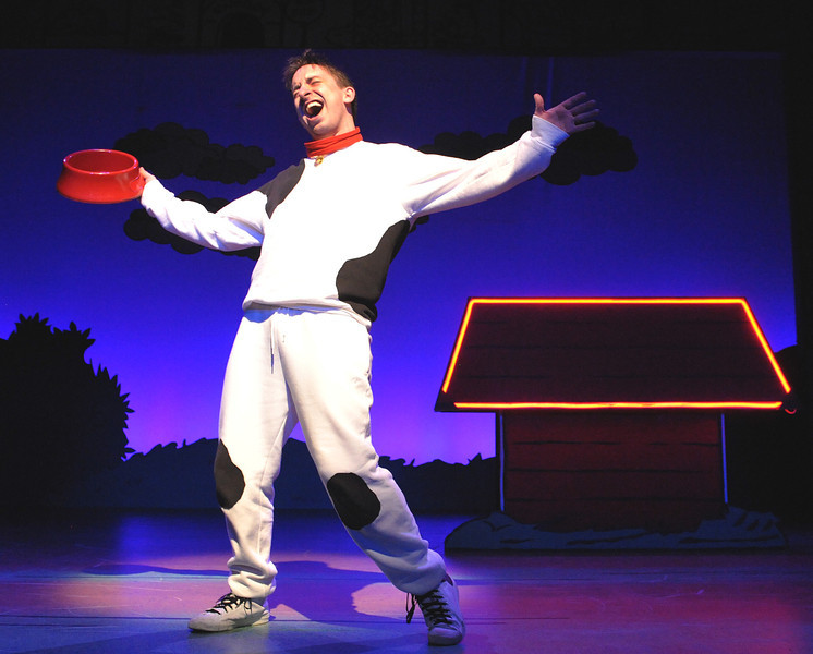 "Snoopy (James Gardiner) sings about the joys of ""Suppertime"" in Olney Theatre Center's production of YOU'RE A GOOD MAN, CHARLIE BROWN.<br /> <br /> (Photo: Stan Barouh)"
