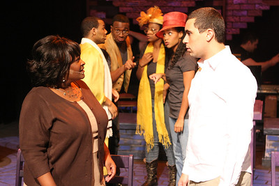 """Keith Parker as the Youth and Talichia Noah as the Mother (in front) in New Line Theatre's """"Passing Strange."""" Also pictured, John Reed II, Cecil Washington Jr., Jeanitta Perkins, Andrea Purnell. Photo credit: Jill Ritter Lindberg."""