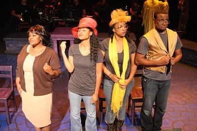 "Talichia Noah, Andrea Purnell, Jeanitta Perkins, and Cecil Washington Jr., in New Line Theatre's ""Passing Strange."" Photo credit: Jill Ritter Lindberg."