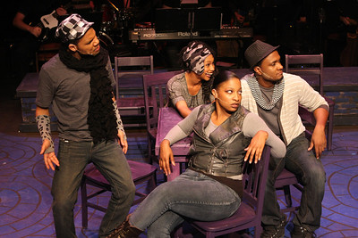 """John Reed II, Andrea Purnell, Jeanitta Perkins (front), and Cecil Washington Jr., as the artists of Nowhaus in New Line Theatre's """"Passing Strange."""" Photo credit: Jill Ritter Lindberg."""