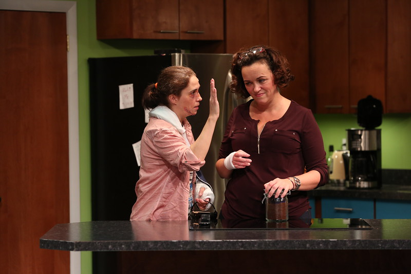 Molly (Holly Twyford) attempts to keep the peace with her sister Linda (Emily Townley) in Olney Theatre Center's production of BAD DOG. (Photo Nicholas Griner)