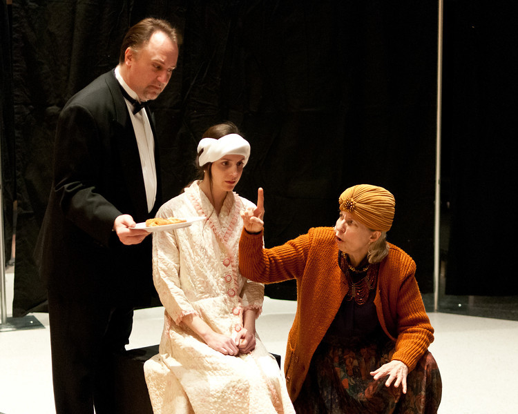 Scene from Blithe Spirit: Charles (Mike Fisher),  Edith (Caity Brown), and Madame Arcati (Leah Mazade)