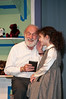 Kris Kringle (Vin Kelly) speaks to a little Dutch girl (Lily Tender) recently arrived in America in her own language.