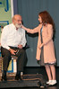 Kris Kringle (Vin Kelly) has his beard pulled by a skeptical Susan Walker (Mary Sorensen).