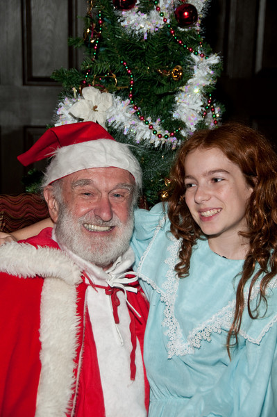 "Vin Kelly plays ""Kris Kringle"" and Mary Sorensen plays ""Susan Walker"" in the Potomac Theatre Company production of ""It's Beginning to Look a Lot Like Christmas""."