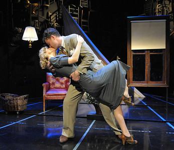 A kiss can mean many things in Hitchcock's suspenseful farce, THE 39 STEPS starring Jeffries Thaiss & Susan Lynskey.  Photo Credit: Stan Barouh