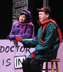 "The doctor's in! Lucy (Janine Sunday) helps Charlie Brown (Zack Colonna) work through some of his ""issues"" in Olney Theatre Center's production of YOU'RE A GOOD MAN, CHARLIE BROWN.  (Photo: Stan Barouh)"