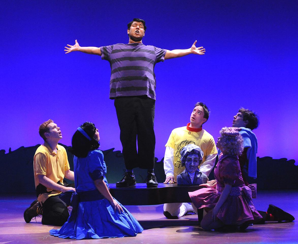 "Schroeder (Vishal Vaidya) tells the Peanuts gang about his dream for ""Beethoven Day"" in Olney Theatre Center's production of YOU'RE A GOOD MAN, CHARLIE BROWN.  (Photo: Stan Barouh)"